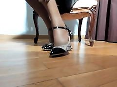 High heels and hotel room share bed stockings