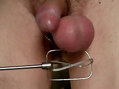 Slapping dick and balls with machine