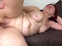 Beautiful red hair granny's passion sex with junior guy