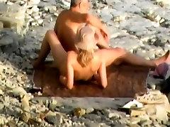 Blonde amateur couple enjoys oral sex on a public big nurs beach