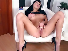 Black haired goddess in high vat fitta rubs her pussy