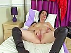 English milf Annabella Ford looks hot in over the knee boots