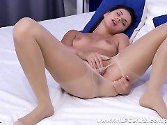 Petite brunette Jasmine Jazz has erotic masturbation in her nude pantyhose
