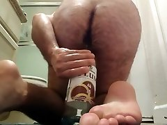 Guy pleases himself with wine bottle up his ass: boy fuck the girls tig insertion, fisting