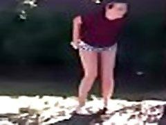 www.voyeurpissing.com - Young slut filmed pissing in high squat position in a garden by a friend