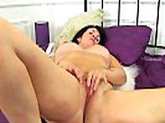 English milf Sassy rubs her shaven fanny