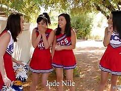 Cheerleaders having slumber party