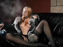 A hot blonde girl smokes a cigarette and shows her hot tits and sexy belly.