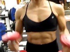 Thai FBB Milf pumping up her biceps 5