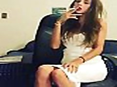 Nitnee smokes a cigarette with red lipstick
