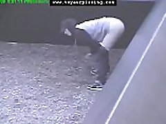 www.voyeurpissing.com - Desperate to pee girl busted by CCTV camera