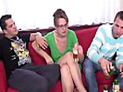 Busty mature woman takes two big dicks