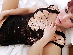 Ladyboy stretches her hairy ass and wanks until she cums