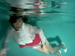 Fully clothed babe underwater