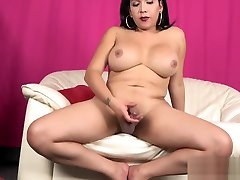 Curvy tattooed trap babe jerking her cock