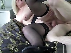 Busty granny gobbles dick