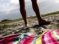 NAKED MAN SUNBATHING AT BEACH