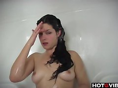 Sexy Brunette takes a shower and plays with her pussy
