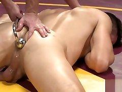 Wrestling stud pins down naked opponent
