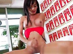 Beautiful Tan stroking her huge cock until a blasting ending