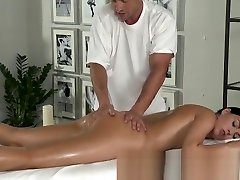 Massage Rooms Young black haired beauties enjoy creampie