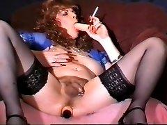 Natasha playing with her dildos while smoking