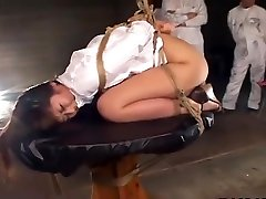 Hot Asian babe in bondage gets an enema