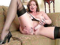 Redhead Milf masturbates big dildo in electra osiyana lingerie nylon