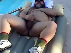Big xxx bpinay jacking off on top of an inflatable air mattress