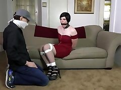 Crossdresser tied and ring gagged