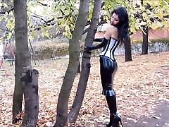 Tightly Laced Corset plus Latex and High Heel Boots in Publi