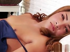 Asian Ladyboy Ning shows her beautiful body and jerks her huge shedick