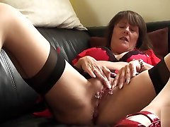 Pierced mature submissive rubs her pussy