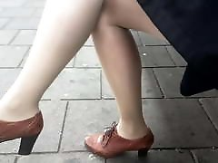 Hot secretary in shiny nude pantyhose at train station
