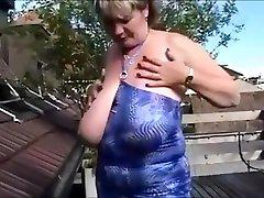 Big tit mature public show