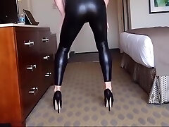 sissy wiggling in tight black leggings and high heels