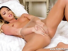 Natalia Forrest strips down to pantyhose and vigorously fingers moist pussy