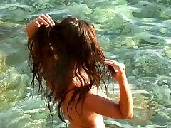 Naturally Sexy Hot Mallorca Girl´s Shiny Gray Bikini Strip on the Rocks
