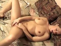 Alluring babe rams her fingers deep in her moist slot