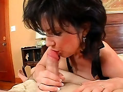 Busty MILF gives BJ and gets doggy style fucked