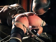 Teen sex slave is tied up and fucked while getting spanking