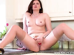 Hot housewife Eva Johnson strips and opens long nylon legs for juicy wank