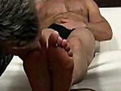 Muscular stud wanks off while fak reb gay licks his bare feet