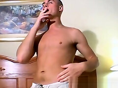 Smoking twink plays with a big butt plug and his fat cock