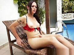 Nikki Montero wanking her cocki by the swimming pool and pissing