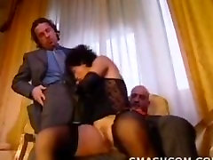 Mature fucked by two guys