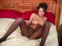 Hot babe rubs her pussy through her nylons and then uses dildo