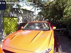 Busty babe giving head to long schlong in car