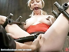 Adrianna Nicole, legs spread wide in metal bondage, helpless and drooling