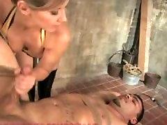 Latex clad dominatrix fucks up pain slut and makes him her little bitch